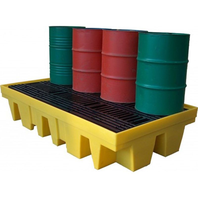 Two green and two red barrels on top of yellow and black platform